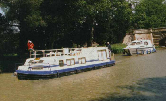 Boats of all types & sizes ply the  			placid waters of the Canal du Midi.