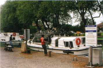 Motor cruisers working through one of the electrically operated locks at Le Somail