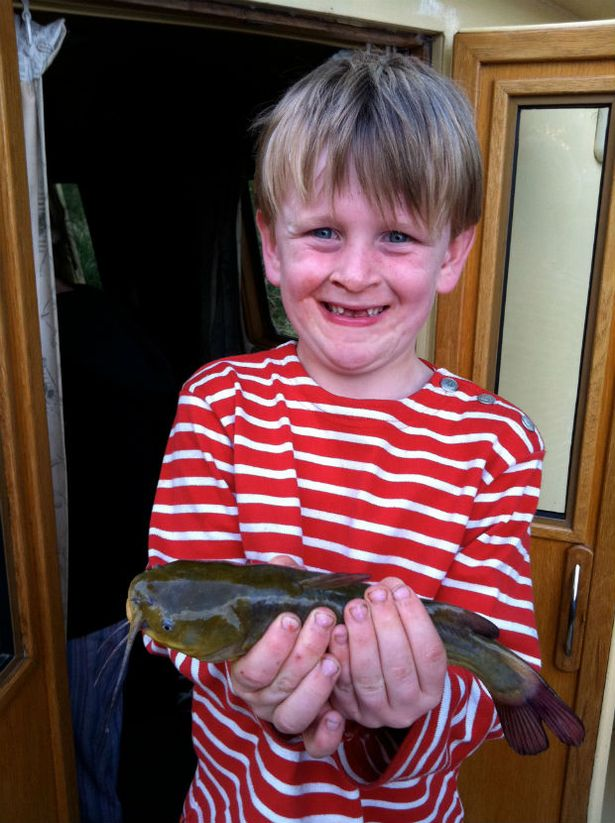 Theo with his first catfish - the fish was returned unharmed